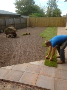 Laying turf in a garden